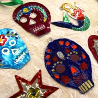 painted tin decorations in the shap of skulls, hearts, stars etc.