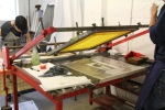 Screen printing using vacuum beds during a course