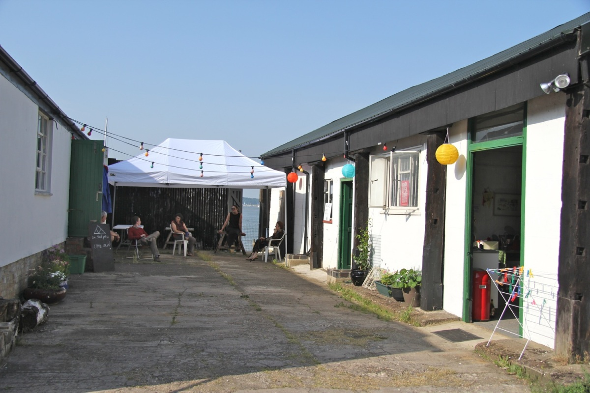 Studios and at Medway Fine Printmakers, with printmakers sitting under a gazebo in the yard