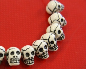 painted clay skull beads