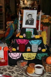 Shrine with photo of a man and paper cut banners