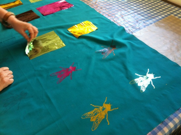 Textile print of flies with heatpress foil effect