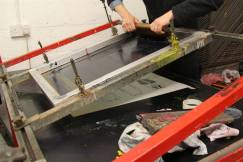 Screen printing on paper with a vacuum table