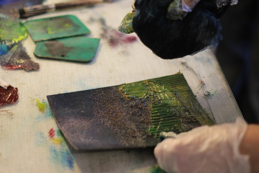 Collagraph plate being inked with scrim