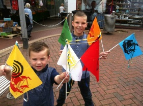 Two boys with flags they have printed