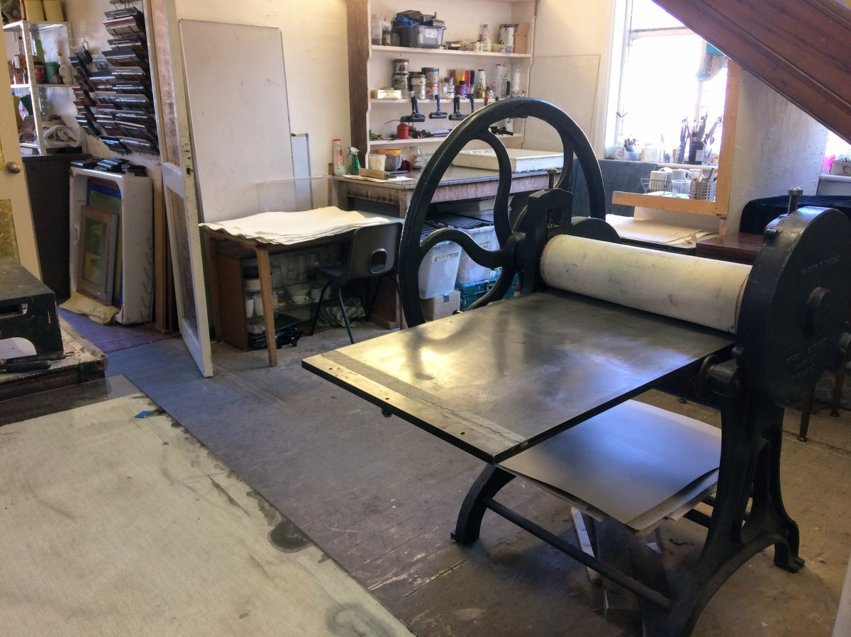 Large etching press in a print room